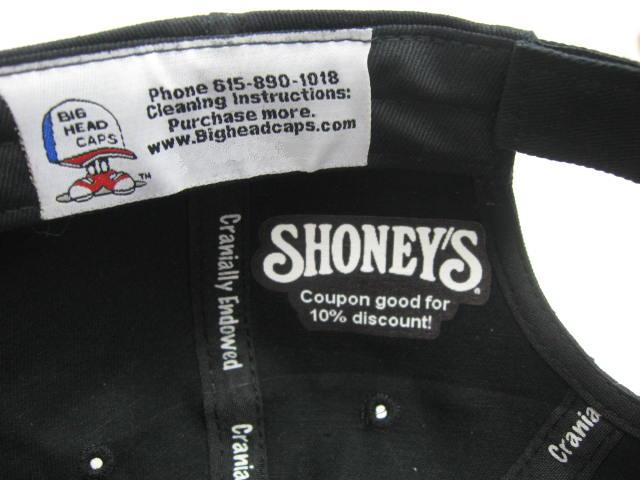 picture showing business label inside of baseball cap
