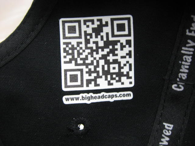 showing a qr code inside a baseball cap